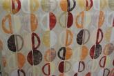 Mokka ljusbotten med mönster i orange och bruna toner
