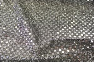 silver paljett på svart botten
