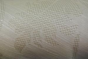 ljust möbeltyg med invävt mönster