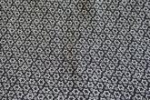 svart botten småmönstrad i grått och beige