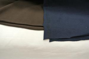 taitstyg i vitt ,brun och marinblå