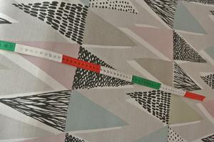 pastellfärgade trianglar i olika färger
