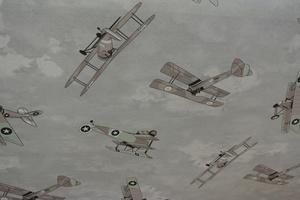 ljus grå  botten med flygplan